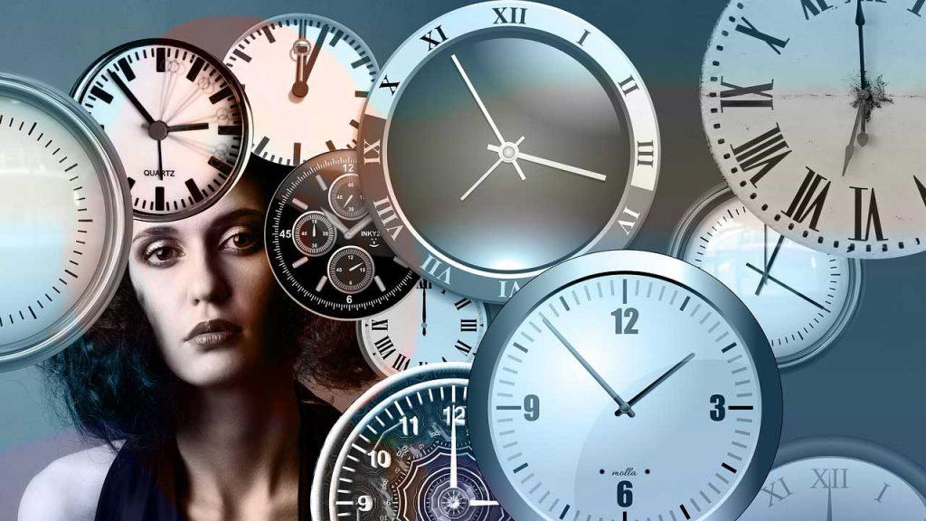 lady amid clock faces
